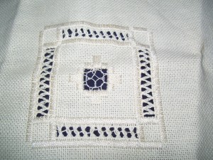 white on ecru cut work embroidery